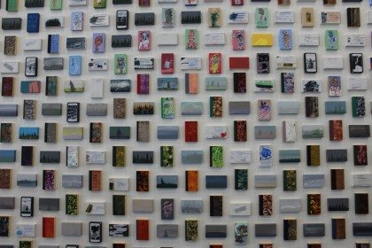 A collage of library-card-sized paintings