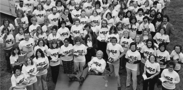 A black and white photo of a group of people in tshirts