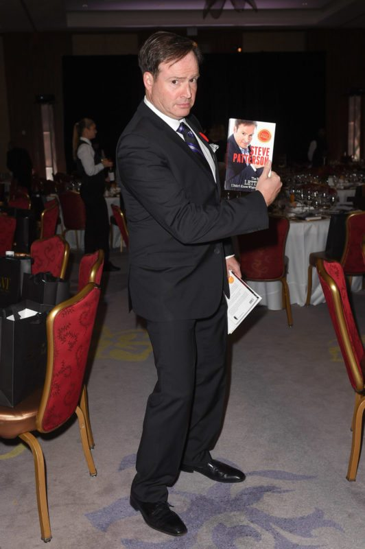 Steve Patterson poses with his own book