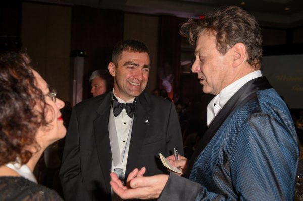 A woman and two men in conversation