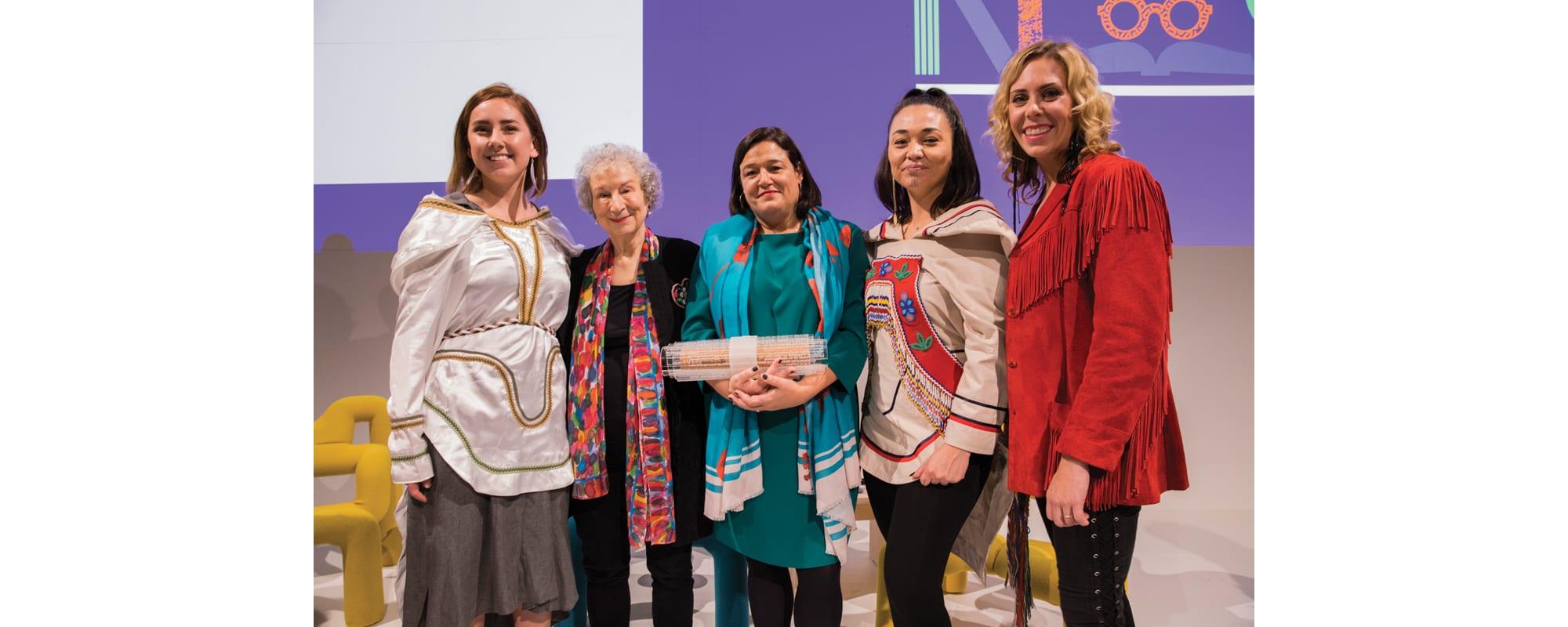 Alexia Galloway-Alainga, Margaret Atwood, Caroline Fortin, Charlotte Qamaniq, and Amanda Rheaum at the Frankfurt Book Fair handover ceremony. Fortin is holding a ceremonial scroll.