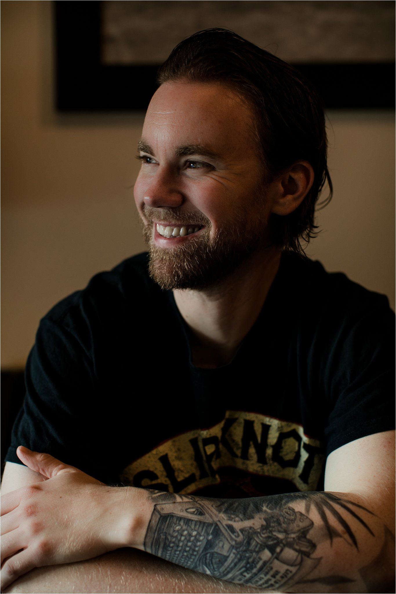 Adam Pottle is grinning in profile in this author headshot