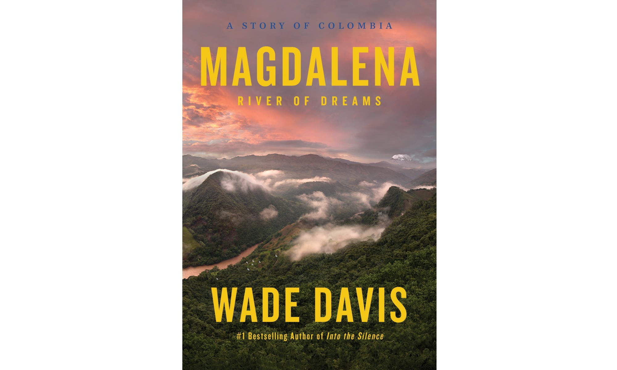 The cover of Wade Davis's book Magdalena featuring a pink sky over a mountainscape