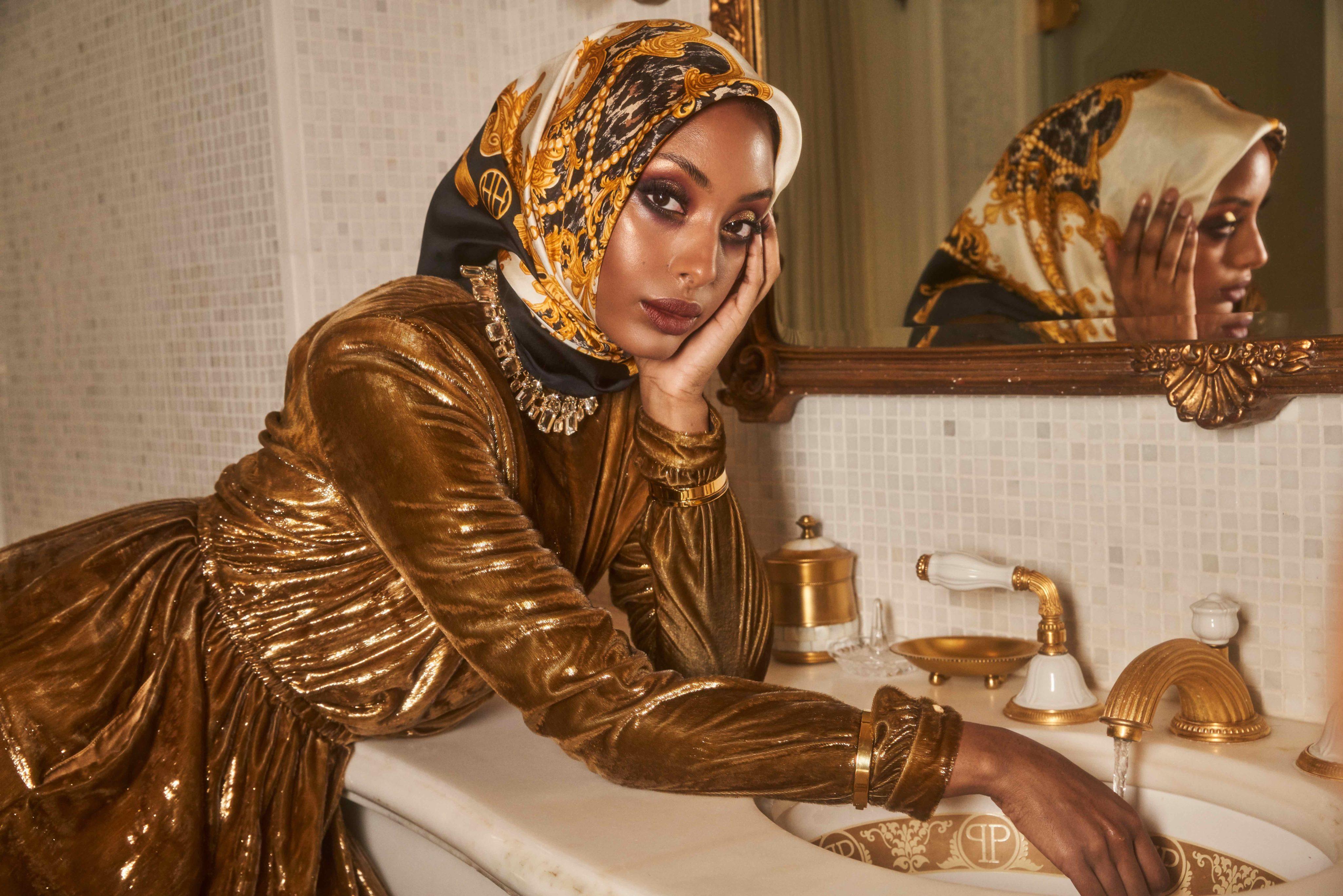 A woman models a hijab